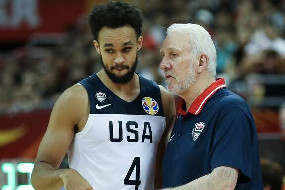 SHANGHAI, CHINA - SEPTEMBER 05:  Head Coach Gregg Popovich of USA talk with Derrick White during the 1st round Group E match between USA and Japan of 2019 FIBA World Cup at the Oriental Sports Center on September 5, 2019 in Shanghai, China.  (Photo by Lintao Zhang/Getty Images)