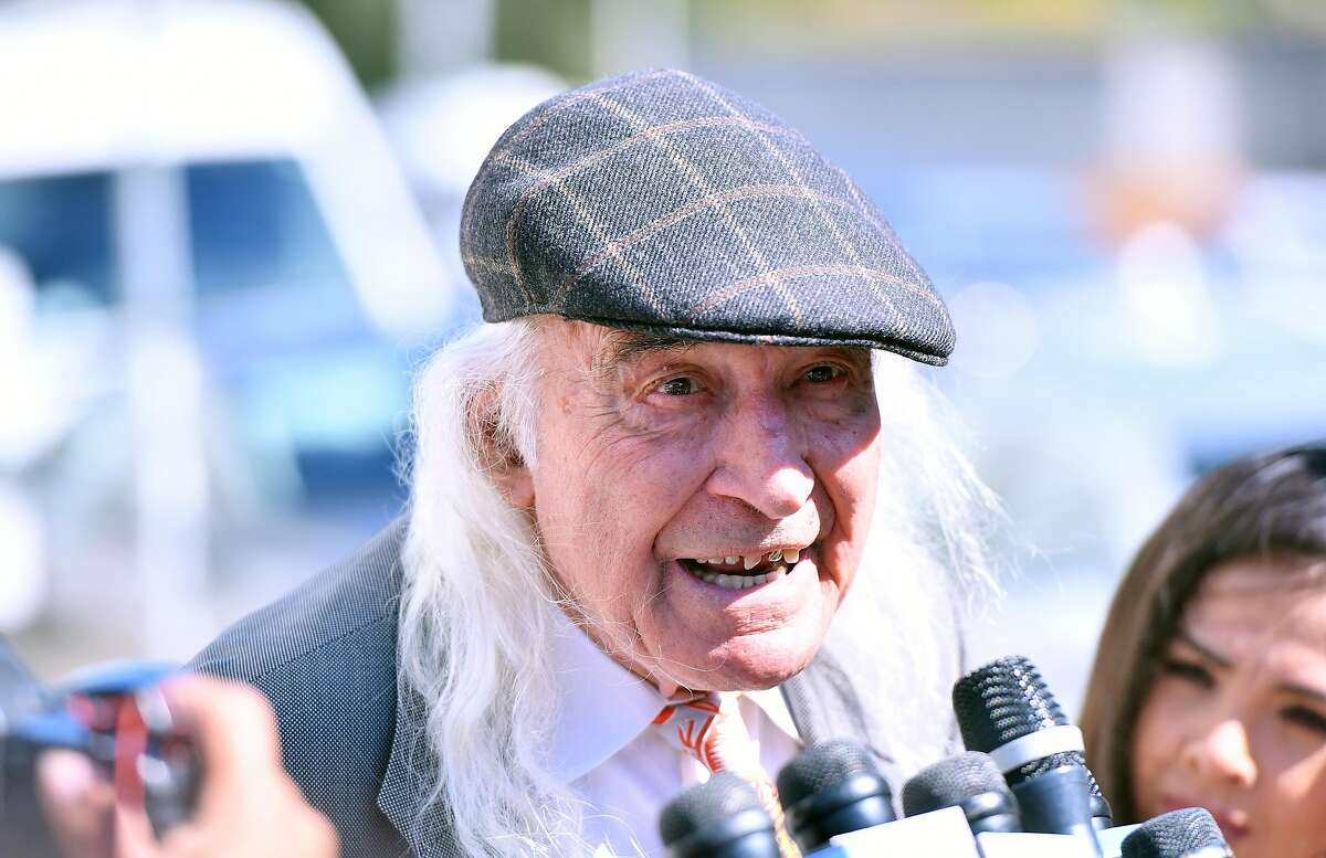 """Defense attorney Tony Serra speaks to members of the media at the conclusion of the involuntary manslaughter trials of Derick Almena and Max Harris, co-defendants in the """"Ghost Ship"""" fire, in Oakland on Sept. 5, 2019."""