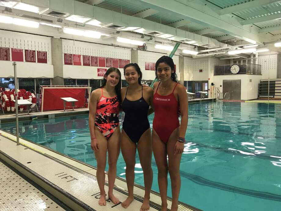 From left to right, Meghan Lynch, Jenna Handali and Regina Frias are captains of the Greenwich High School girls swimming team. Casey Kirsch, not pictured, is also a captain. Photo: Contributed Photo /Contributed Photo