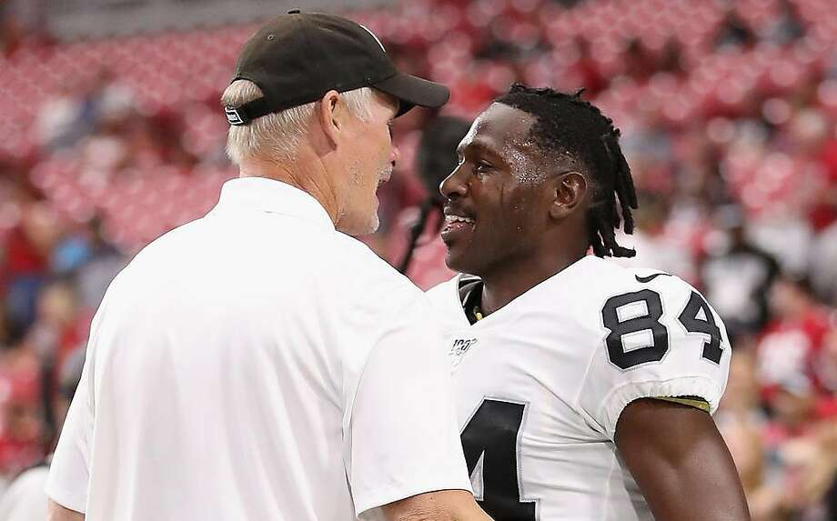 GLENDALE, ARIZONA - AUGUST 15:  Wide receiver Antonio Brown #84 of the Oakland Raiders talks with general manager Mike Mayock before the NFL preseason game against the Arizona Cardinals at State Farm Stadium on August 15, 2019 in Glendale, Arizona. ~~ Photo: Christian Petersen / Getty Images