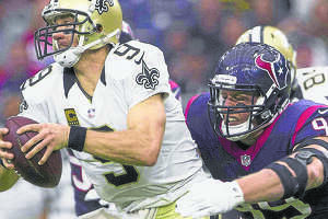 Houston Texans defensive end J.J. Watt sacks New Orleans Saints quarterback Drew Brees during the third quarter of an NFL game Sunday, Nov. 29, 2015, in Houston. Go to HCNpics.com to view more photos from the game.