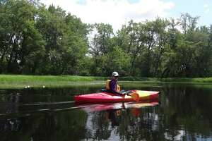 Outdoors writer Gillian Scott enjoys a paddle on the Raquette River. (Photo by Cindi Handy)