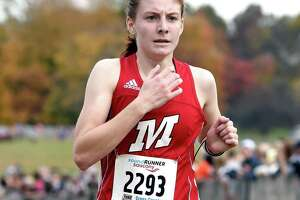 Kate Hedlund of Manchester finishes eleventh in the CIAC Girls Cross Country State Open Championship at Wickham Park in Manchester on November 1, 2018.