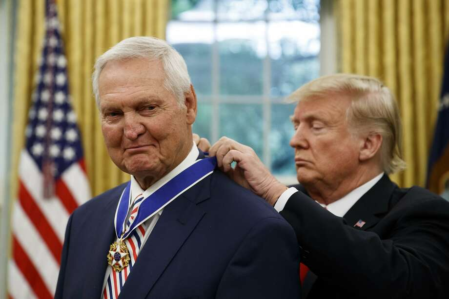 President Donald Trump, right, presents the Presidential Medal of Freedom to former NBA basketball player and general manager Jerry West, in the Oval Office of the White House, Thursday, Sept. 5, 2019, in Washington. (AP Photo/Alex Brandon) Photo: Alex Brandon / Associated Press
