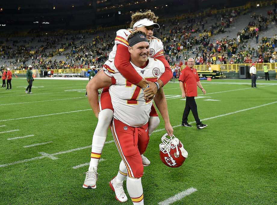 Chiefs quarterback Patrick Mahomes #15 hitches a ride on offensive tackle Andrew Wylie after the preseason game last month. Photo: Quinn Harris / Getty Images