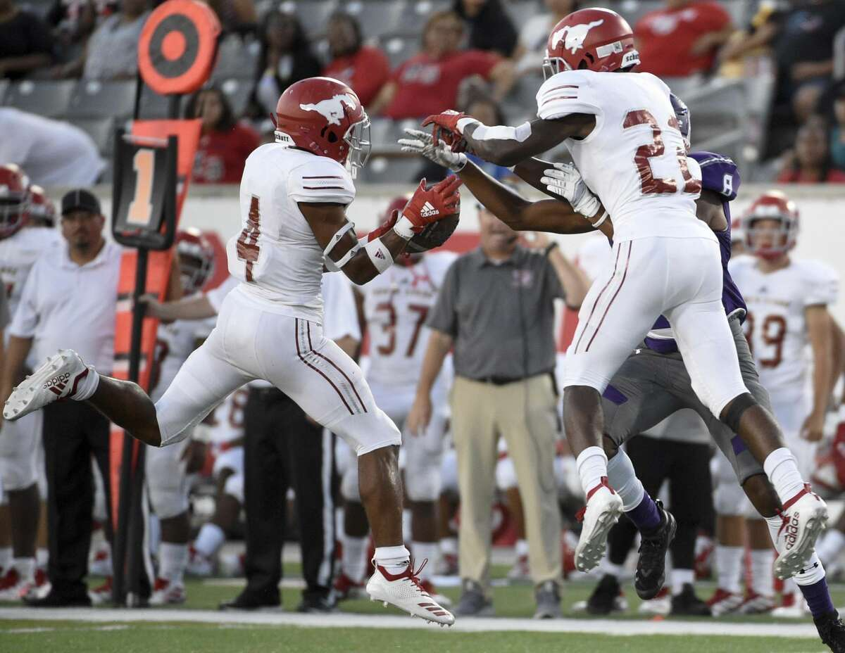 North Shore defensive back Jordan Polart )4) intercepts a pass intended for Ridge Point wide receiver Marvin Session (8) during the first half of a high school football game, Thursday, Sept. 5, 2019, at TDECU Stadium at the University of Houston.