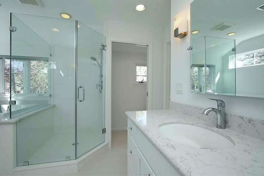 This bathroom remodel is by A-Plus Glass, which is is a member of NAHB, TAB, GHBA, Remodelers Council and the BBB.