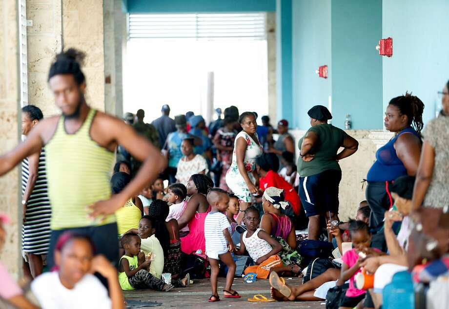 Marsh Harbor residents wait at  Thompson International Airport while trying to evacuate Great Abaco Island on Thursday. Dorian battered the Bahamas as a category 5 hurricane for 2 days. Photo: Jose Jimenez / Getty Images