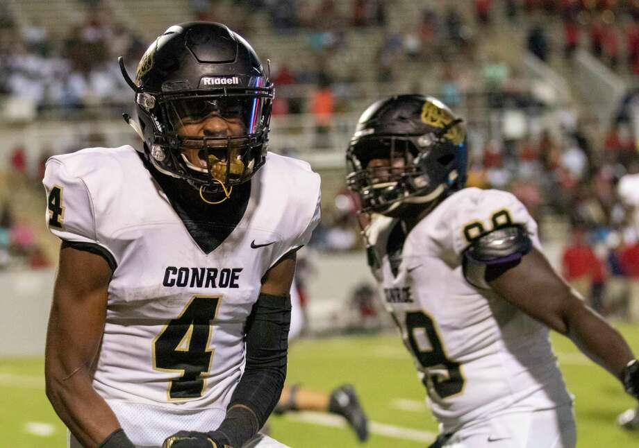 Conroe wide receiver Michael Phoenix (4) celebrates after scoring his third touchdown during a non-district football game Thursday, September 5, 2019 at W.W. Thorne Stadium in Houston. Photo: Cody Bahn, Houston Chronicle / Staff Photographer / © 2019 Houston Chronicle