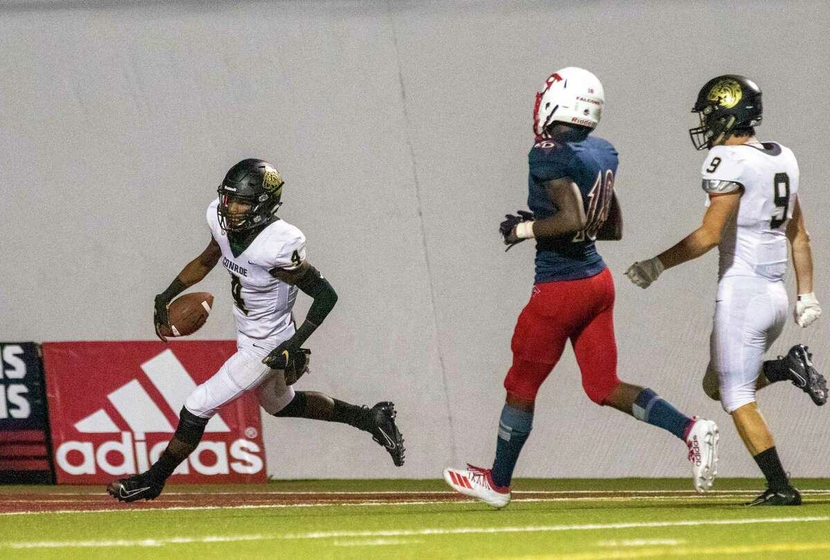 Conroe wide receiver Michael Phoenix (4) scores his third touchdown during a non-district football game Thursday, September 5, 2019 at W.W. Thorne Stadium in Houston.