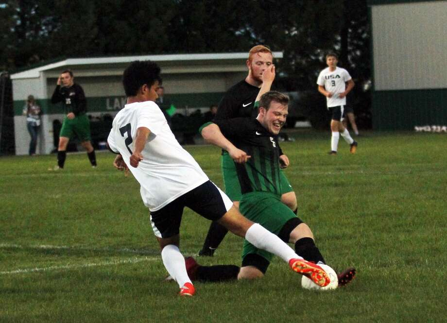 The USA boys soccer team battle Elkton-Pigeon-Bay Port Thursday night in Pigeon. The Patriots won, 4-1. Photo: Mark Birdsall/Huron Daily Tribune