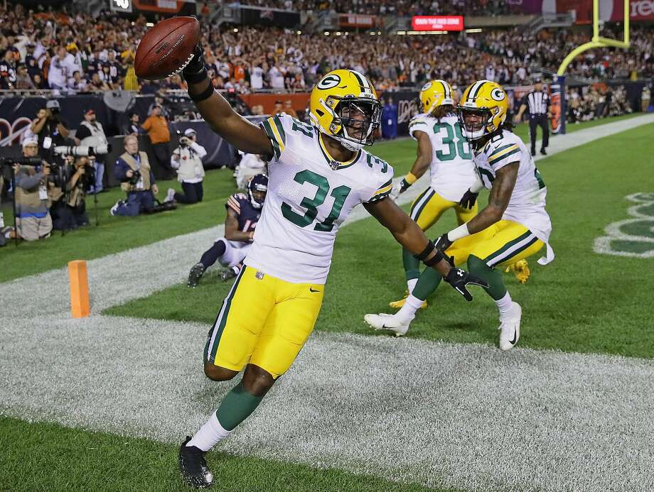 Former Bears safety Adrian Amos picks off an end-zone pass into double coverage with 1:58 remaining to help clinch the Packers victory at Soldier Field in Chicago on Thursday night. Photo: Jonathan Daniel / Getty Images