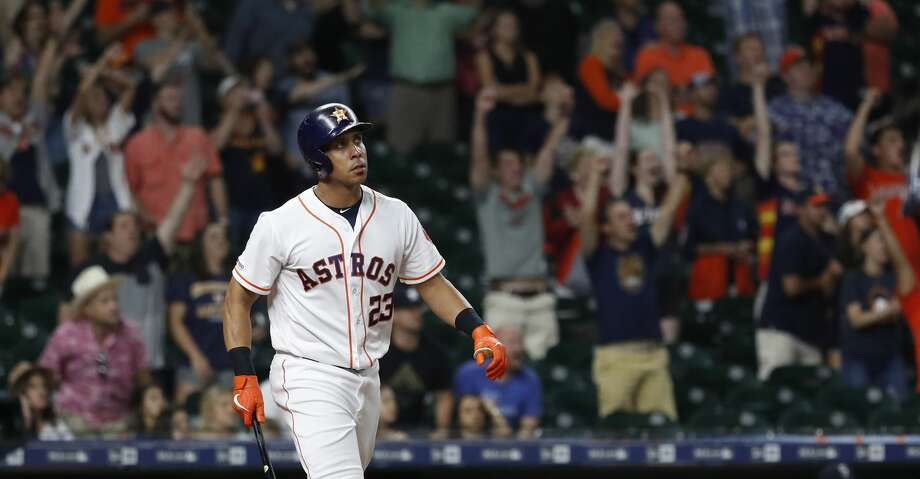 Houston Astros Michael Brantley (23) watches his ball go over the wall for a walk off home run to beat the Seattle Mariners 11-9 during the thirteenth inning of an MLB game at Minute Maid Park, Thursday, September 5, 2019, in Houston. Photo: Karen Warren/Houston Chronicle