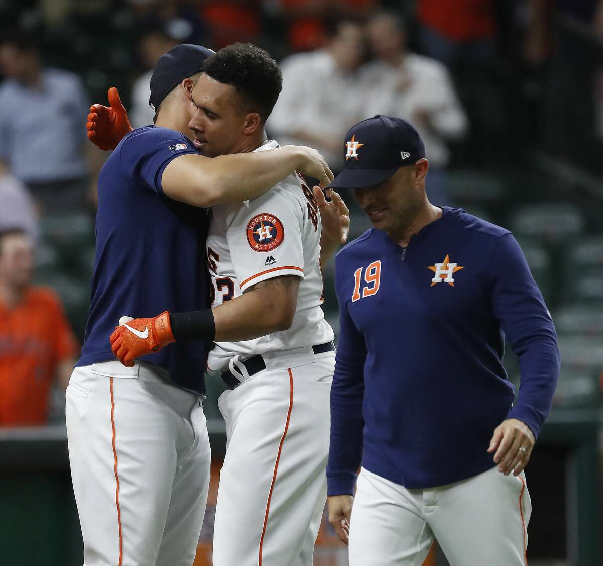 Houston Astros Michael Brantley (23) celebrates with George Springer after his walk off home run to beat the Seattle Mariners 11-9 during the thirteenth inning of an MLB game at Minute Maid Park, Thursday, September 5, 2019, in Houston.