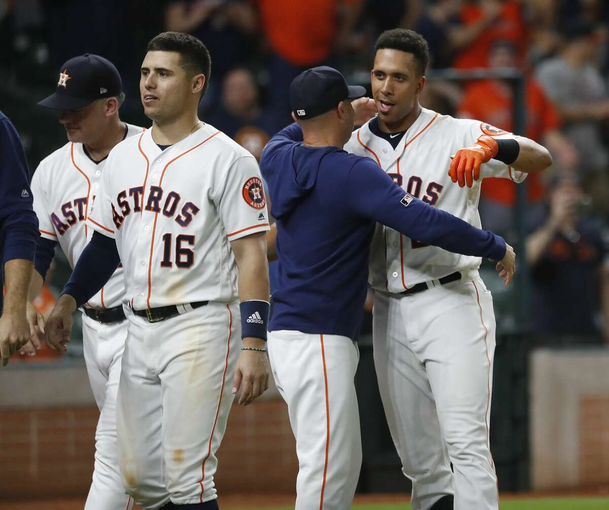 Houston Astros Michael Brantley (23) celebrates with bench coach Joe Espada (19) after his walk off home run to beat the Seattle Mariners 11-9 during the thirteenth inning of an MLB game at Minute Maid Park, Thursday, September 5, 2019, in Houston.