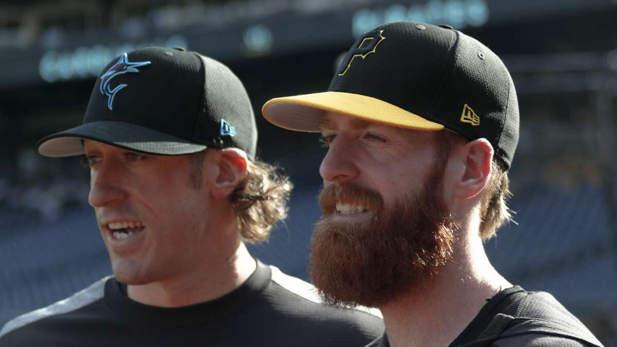Pittsburgh Pirates' Colin Moran, right, stands with his brother Brian Moran, a pitcher for the Miami Marlins, before their teams play against each other in a baseball game, Wednesday, Sept. 4, 2019, in Pittsburgh. (AP Photo/Keith Srakocic)