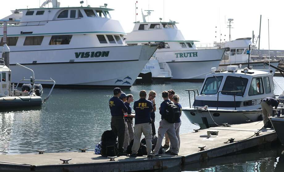 SANTA BARBARA, CALIFORNIA - SEPTEMBER 04: FBI personnel stand on a jetty in front of the ships Vision (L) and Truth, sister vessels of the diving ship Conception, in Santa Barbara Harbor on September 4, 2019 in Santa Barbara, California. Authorities announced that the bodies of 33 victims have been recovered after the Conception caught fire and later sank, while anchored near Santa Cruz Island, in the early morning hours of September 2. Five crew members survived. (Photo by Mario Tama/Getty Images) Photo: Mario Tama / Getty Images