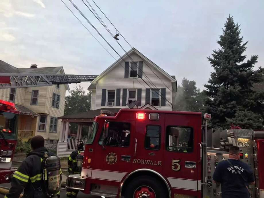 Sixteen people were displaced after a fire that started in the basement quickly traveled to the first floor early Thursday evening on Sept. 5, 2019. All occupants escaped with no injuries. The call for the fire at 13 Grove St, came in at 6:51 p.m. Photo: Norwalk Fire Department Photo