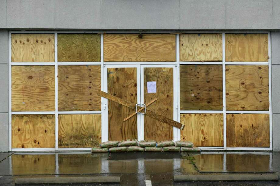A closed business with its windows boarded up and sandbagged in Conway, S.C., as Hurricane Dorian begins to batter the South Carolina coast on Sept. 5, 2019. Photo: Bloomberg Photo By Charles Mostoller. / © 2019 Bloomberg Finance LP
