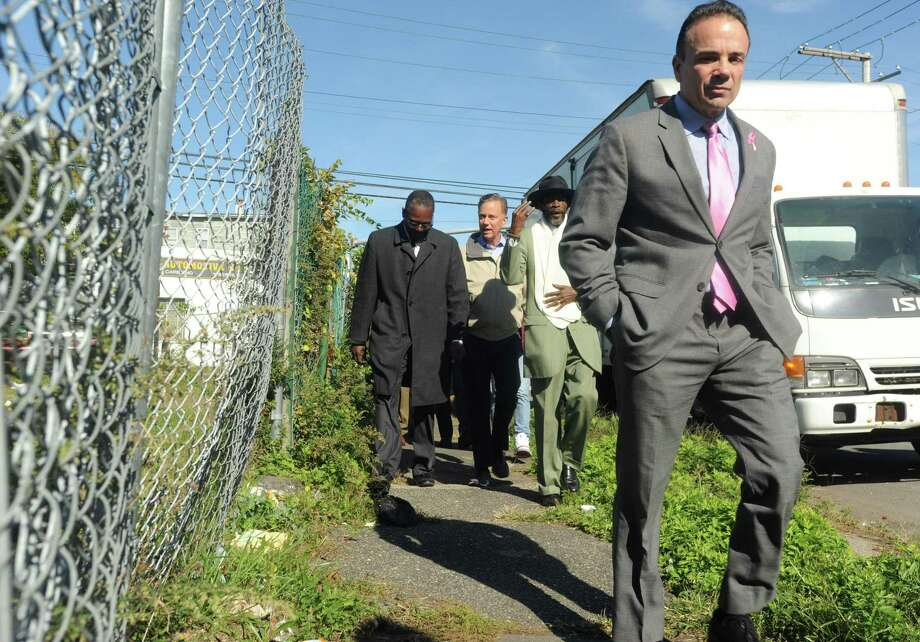 Democratic Town Committee member Tony Barr, Democratic gubernatorial candidate Ned Lamont, City Councilman Ernie Newton and Mayor Joe Ganim walk down Union Avenue during took a walking tour of the high crime neighborhood in Bridgeport, Conn., on Oct. 19, 2018. Photo: Hearst Connecticut Media / Connecticut Post