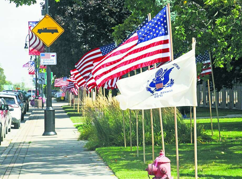 The flags flying along Huron Avenue in Bad Axe will fly a little longer this year. Rick Beaver, Bad Axe VFW 116 post commander, told the Tribune instead of taking the flags down after Labor Day this year, they will remain up for several other important days. Those include Patriot Day, Sept. 11, Constitution Day, U.S. Air Force Day and POW/MIA Recognition Day. The flags will remain until Sept. 22. Photo: Seth Stapleton/Huron Daily Tribune