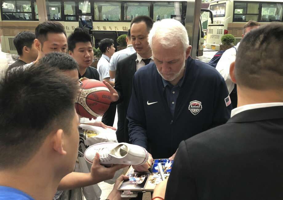 U.S. men's basketball coach Gregg Popovich signs autographs for fans Thursday, Aug. 29, 2019, at the team hotel in Shanghai upon arrival for the World Cup. The team will play three first-round games starting Sunday. (AP Photo/Tim Reynolds) Photo: Tim Reynolds/AP