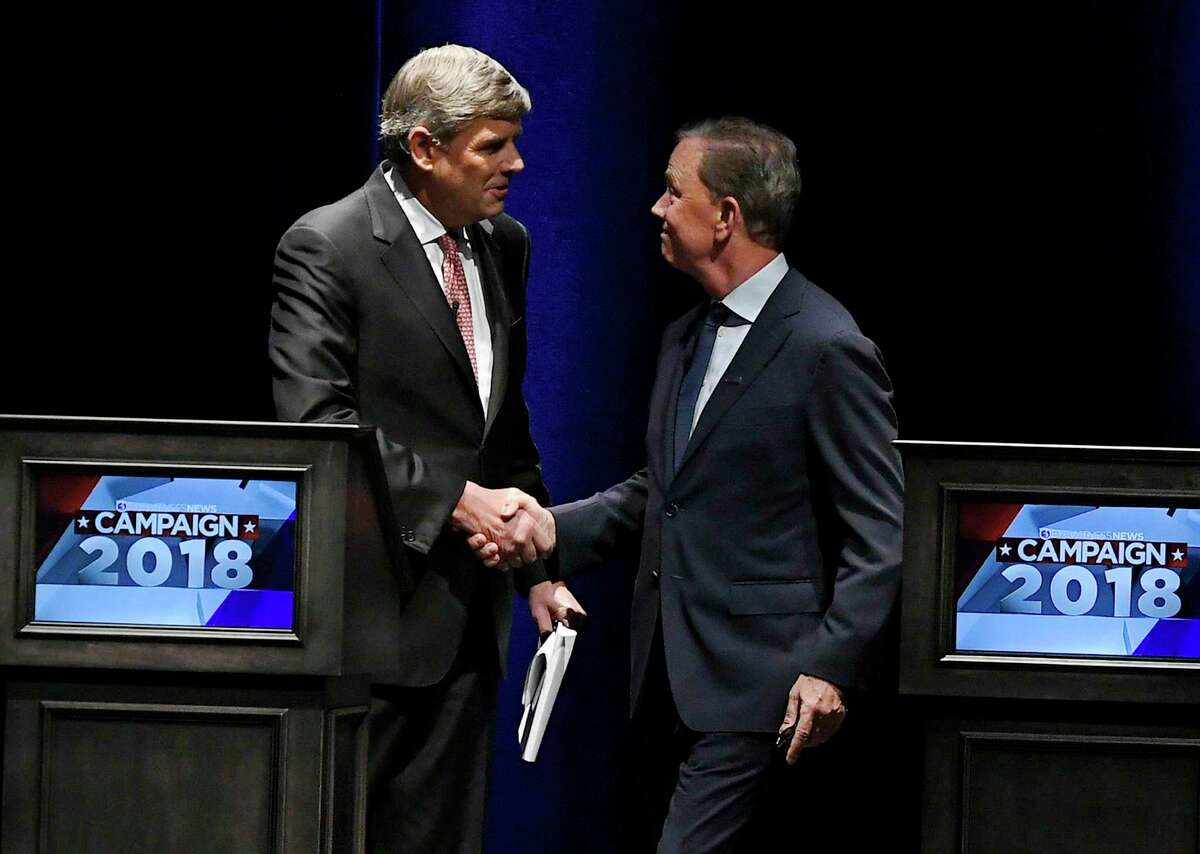 Republican Party candidate Bob Stefanowski, left, shakes hands with Democratic Party candidate Ned Lamont, at the end of a gubernatorial debate at the University of Connecticut in Storrs, Conn., Wednesday, Sept. 26, 2018. (AP Photo/Jessica Hill)