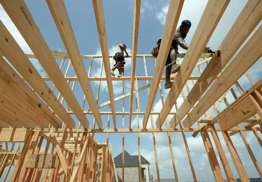 Workers build framing Friday for one of several homes currently under construction at the Diamond D Ranch on Highway 90. Photo taken Friday, 6/28/19 Photo: Guiseppe Barranco/The Enterprise, Photo Editor / Guiseppe Barranco ©