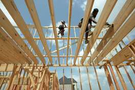 Workers build framing Friday for one of several homes currently under construction at the Diamond D Ranch on Highway 90. Photo taken Friday, 6/28/19