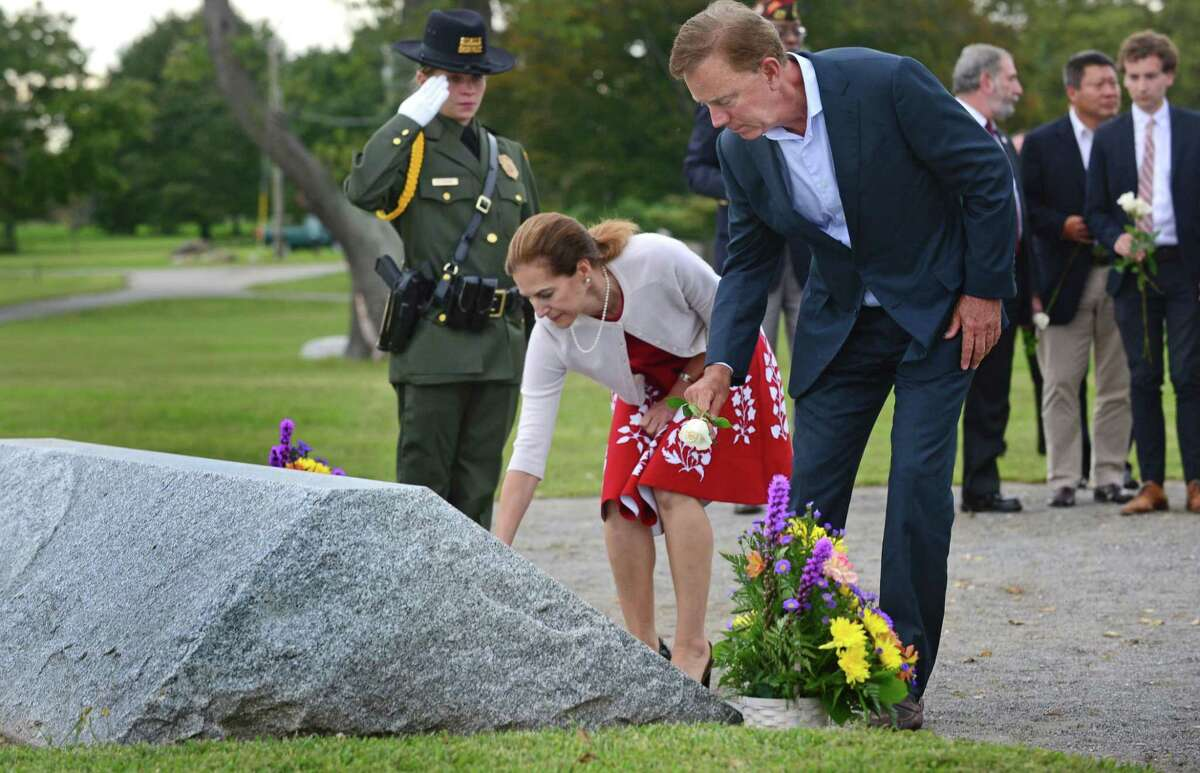 Governor Ned Lamont and Lt. Governor Susan Bysiewicz lay roses at the memorial as they host the State of Connecticut's 18th annual 9/11 Memorial Ceremony honoring and celebrating the lives of those killed in the September 11, 2001 terrorist attacks on Thursday at Sherwood Island State Park in Westport. Family members of those who were killed in the attacks participated, and the names of the 161 victims with ties to Connecticut were read aloud.
