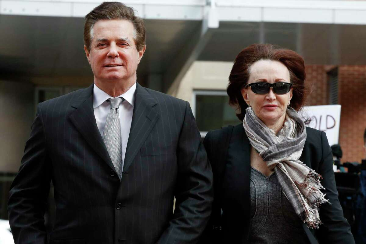 In a March 2018, file photo, Paul Manafort, President Donald Trump's former campaign chairman, walked with this wife Kathleen Manafort, into the Alexandria Va. Federal Courthouse.