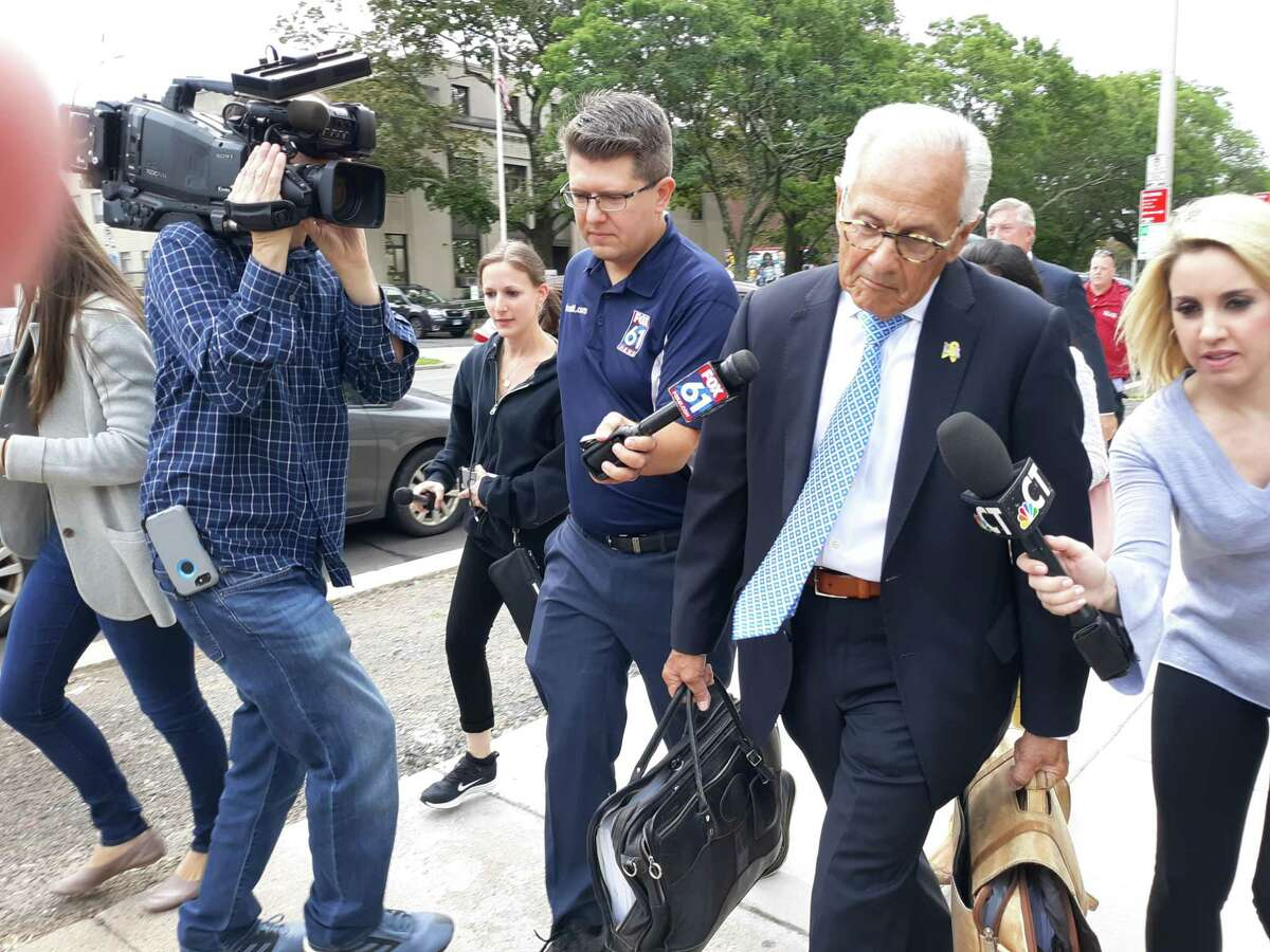Gloria Farber's attorney, Richard Weinstein, leaves the Hartford courthouse on Friday.