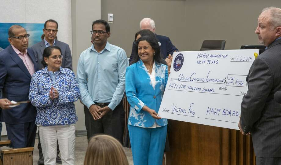 Members of the Hindu Association West Texas present a donation for the victims of last weekend's shootings 09/06/19 during a press conference at Odessa City Hall. Tim Fischer/Reporter-Telegram Photo: Tim Fischer/Midland Reporter-Telegram