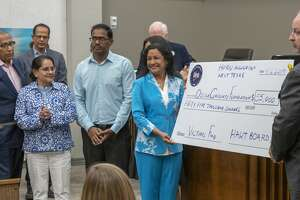 Members of the Hindu Association West Texas present a donation for the victims of last weekend's shootings 09/06/19 during a press conference at Odessa City Hall. Tim Fischer/Reporter-Telegram