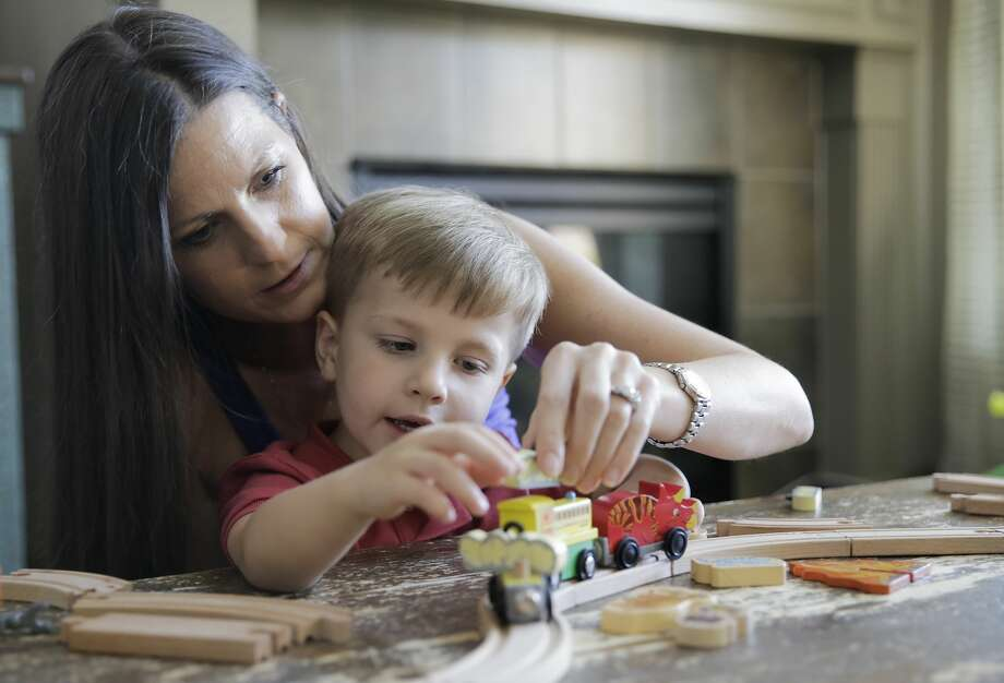 Ann Marie Timmerman plays with her youngest son, Tristan, in their Cinco Ranch home in Katy. Photo: Elizabeth Conley/Staff Photographer