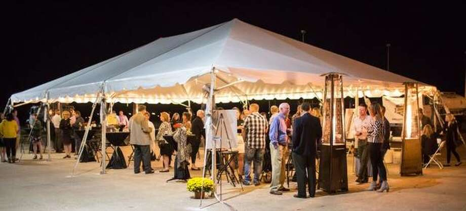 In this file photo, guests of the OSF HealthCare Saint Anthony's Health Center biennial Moonlight Mixer gather in 2017. This year's event is planned Saturday, Sept. 28.