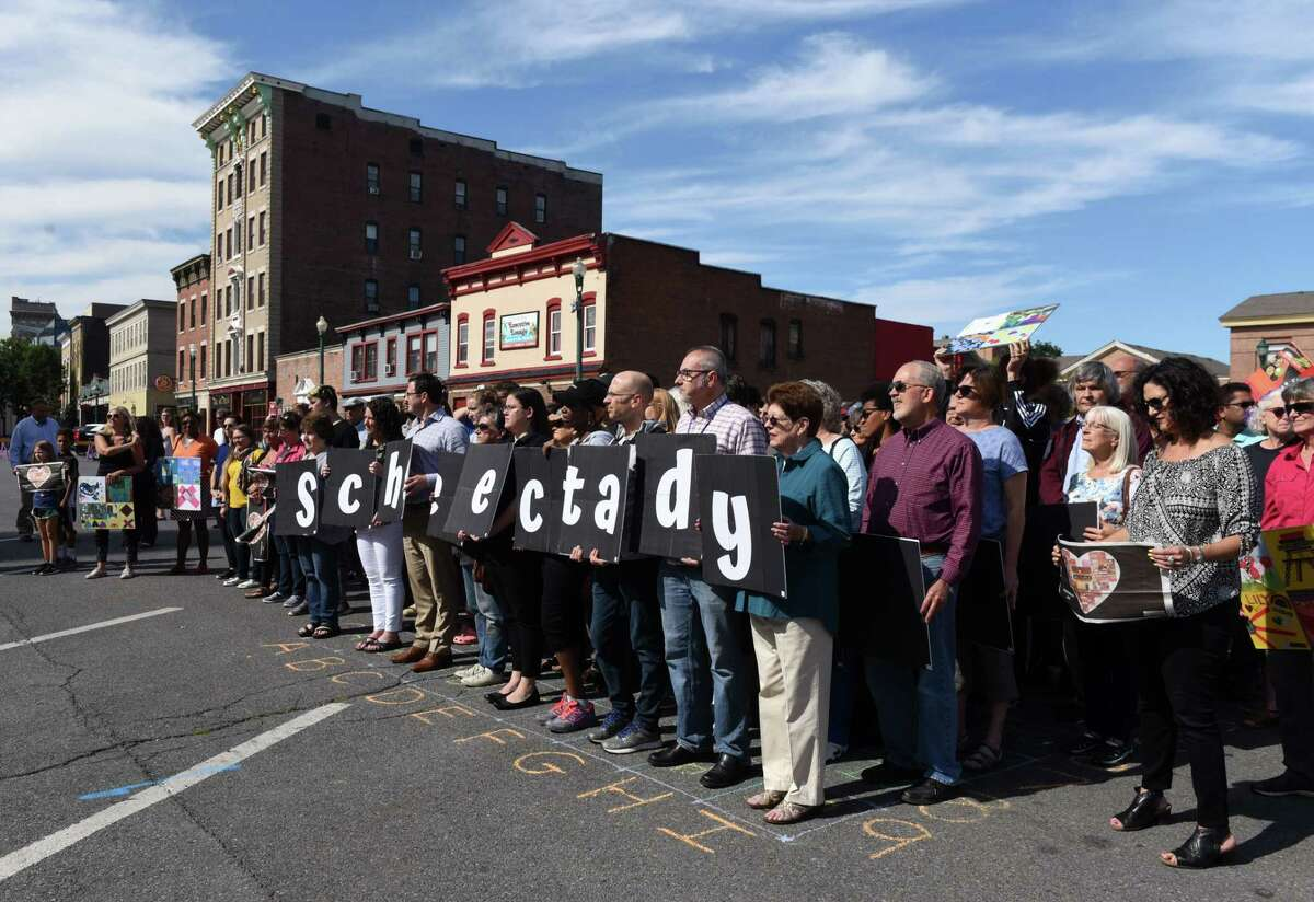 The Schenectady & Me Sculptural Project was kicked-off with a human mosaic outside City Hall on Friday, Sept. 6, 2019, in Schenectady, N.Y. The art project is a culmination of collages, created by members of the community, digitized and made into tiles. The tiles are to be used in the creation of benches that will be placed in locations all around Schenectady. (Will Waldron/Times Union)