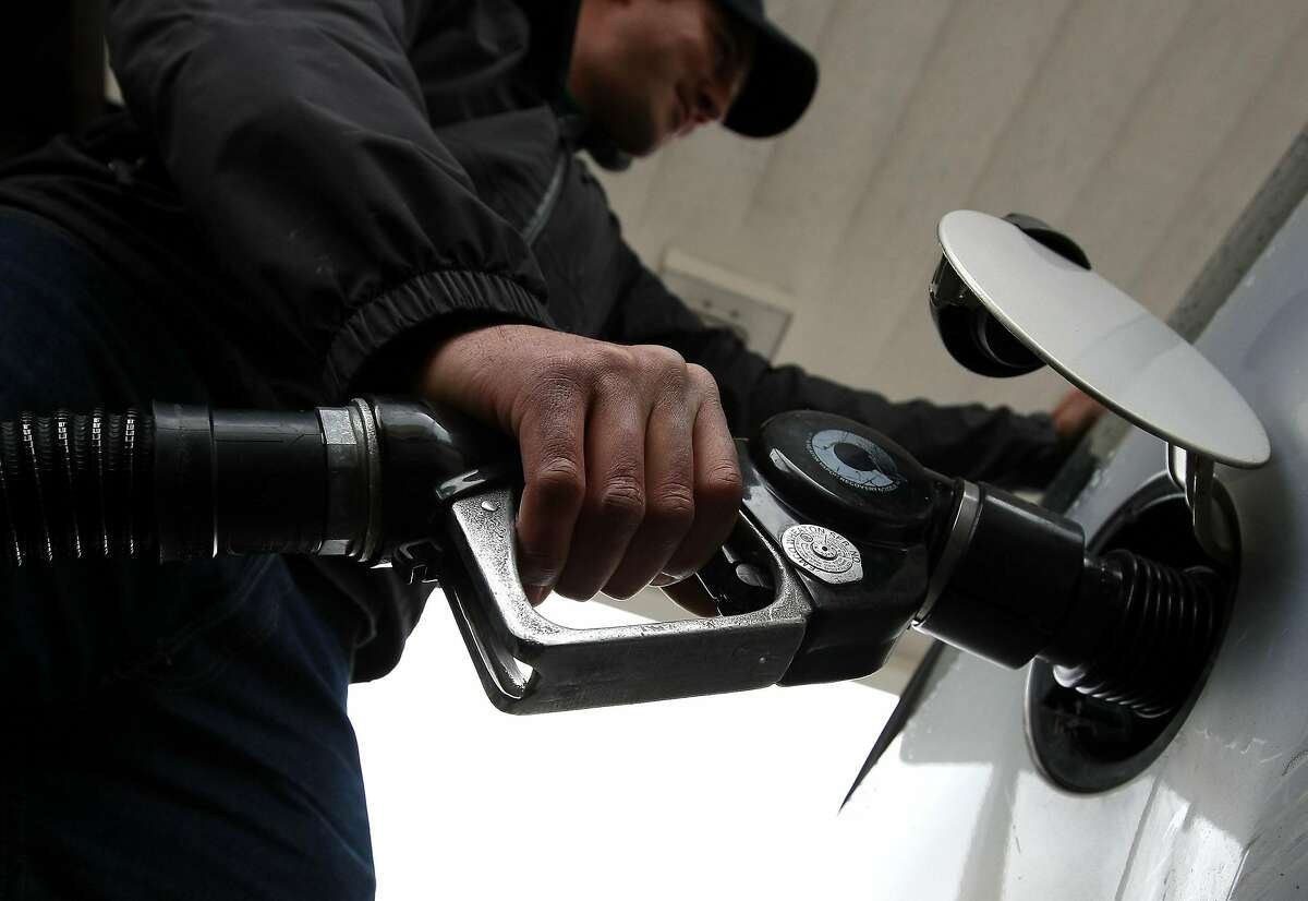 A man pumps gas into his car in San Francisco.