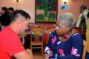 State Senator Marilyn Moore, who is running for mayor of Bridgeport, listens to the concerns of voter Hung Ngo during a fundraiser at Coyote Flaco restaurant in Bridgeport Aug. 27. She is challenging Democratic Mayor Joe Ganim in a primary Tuesday.