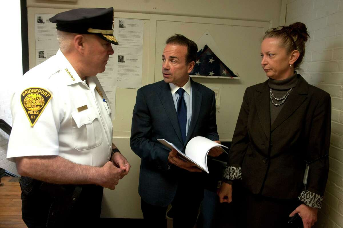 Mayor Joe Ganim speaks with Police Chief Armando Perez and Rowena White, Director of Communications for the City of Bridgeport prior to an Oath of Office ceremony for new police recruits in Bridgeport, Conn. April 29, 2019.