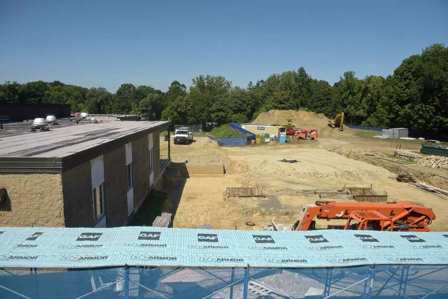 Construction of the new gym and an amphitheater at Ralph M.T. Johnson School in Bethel, Conn. Photo: H John Voorhees III / Hearst Connecticut Media / The News-Times