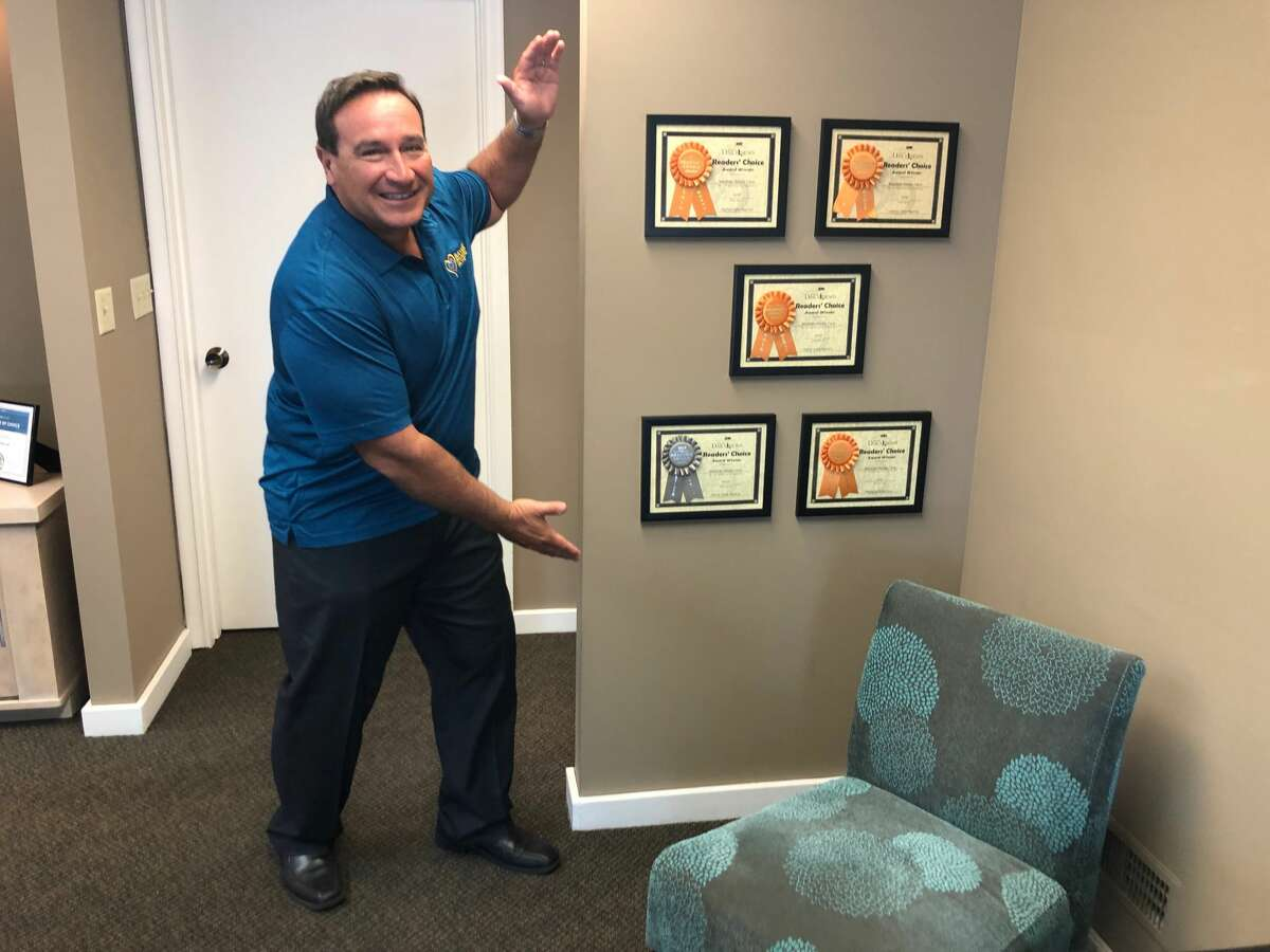 Bayside Home Care Owner Gary Vogel poses with some prior Reader's Choice awards. This year, readers once again voted Bayside Home Care best home care agency. No. 2 was Great Lakes Home Care Unlimited, and No. 3 was Right at Home. (Kate Hessling/khessling@hearstnp.com)