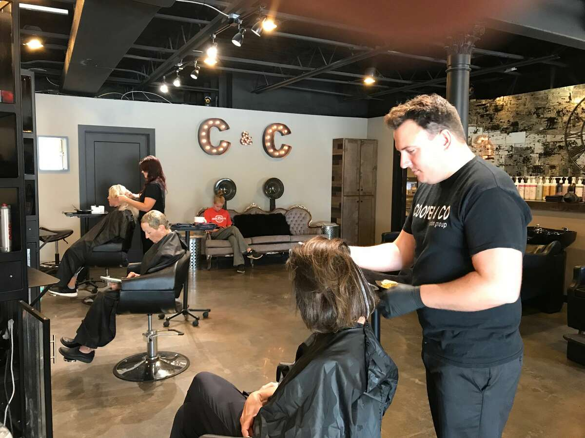 Ethan Cooper, owner, works on a client's hair at Cooper & Co. Salon in Midland. The salon was named best barbershop as well as best nail salon in the 2019 Daily News Readers Choice Awards. In the nail salon category, No. 2 was Le Posh Salon & Spa, and No. 3 was LA Nails. In the barbershop category, No. 2 was Irish's Barber Shop, and there was a two-way tie for No. 3, involving Gordon's Barber Shop and Sport Clips. (Lori Qualls/lqualls@mdn.net)