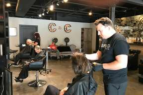 Ethan Cooper, owner, works on a client's hair at Cooper & Co. Salon in Midland. The salon was named best barbershop as well as best nail salon. In the nail salon category, No. 2 was Le Posh Salon & Spa, and No. 3 was LA Nails. In the barbershop category, No. 2 was Irish's Barber Shop, and there was a two-way tie for No. 3, involving Gordon's Barber Shop and Sport Clips. (Lori Qualls/lqualls@mdn.net)