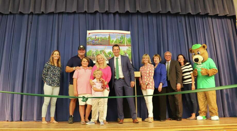 "Pictured, from right to left, are Branchville mascot ""Bob the Beaver,"" PTA co-president Angela Rice, First Selectman Rudy Marconi, Interim Superintendent JeanAnn Paddyfote, school board Chair Margaret Stamatis, Principal Keith Margolus, Tommy Bishop, Liam Bishop, Kim Bishop, Chris Bishop and PTA co-president Sarah Pettitt. Photo: Contributed Photo"