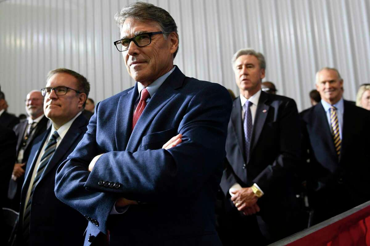 Energy Secretary Rick Perry, center and Environmental Protection Agency administrator Andrew Wheeler, left, listen as President Donald Trump speaks during a visit to the Pennsylvania Shell ethylene cracker plant on Tuesday, Aug. 13, 2019 in Monaca, Pa. (AP Photo/Susan Walsh)