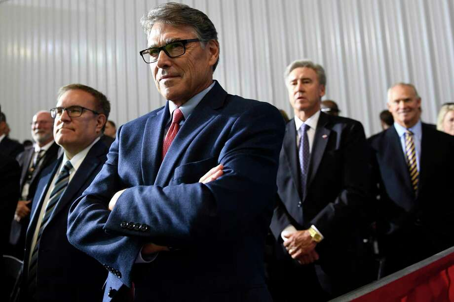 Energy Secretary Rick Perry, center and Environmental Protection Agency administrator Andrew Wheeler, left, listen as President Donald Trump speaks during a visit to the Pennsylvania Shell ethylene cracker plant on Tuesday, Aug. 13, 2019 in Monaca, Pa. (AP Photo/Susan Walsh) Photo: Susan Walsh, STF / Associated Press / Copyright 2019 The Associated Press. All rights reserved.