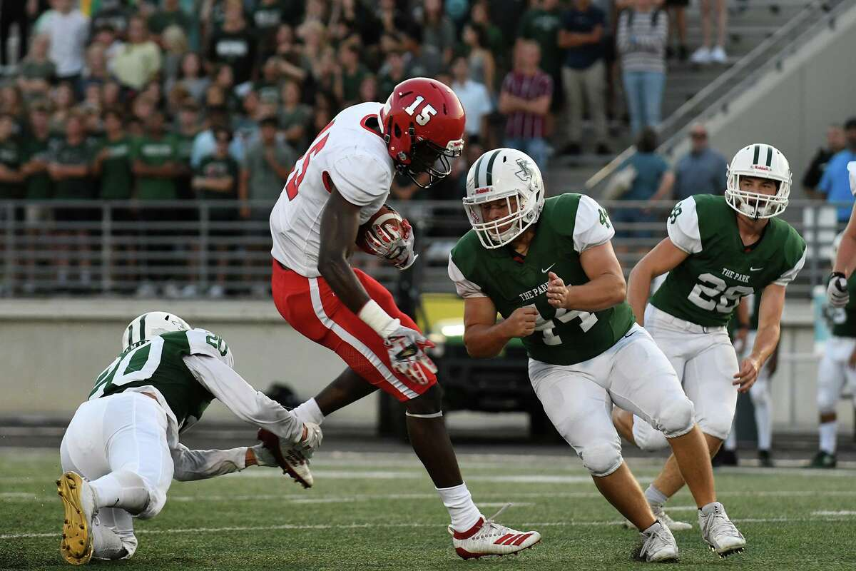 Kingwood Park senior linebacker Thomas Kirby ((44) and junior defensive back Brandon Acosta (20) team-up to stop Waltrip senior receiver Orvis Fowler (15) in the 1st quarter of their matchup at Turner Stadium in Humble on Sept. 5, 2019.