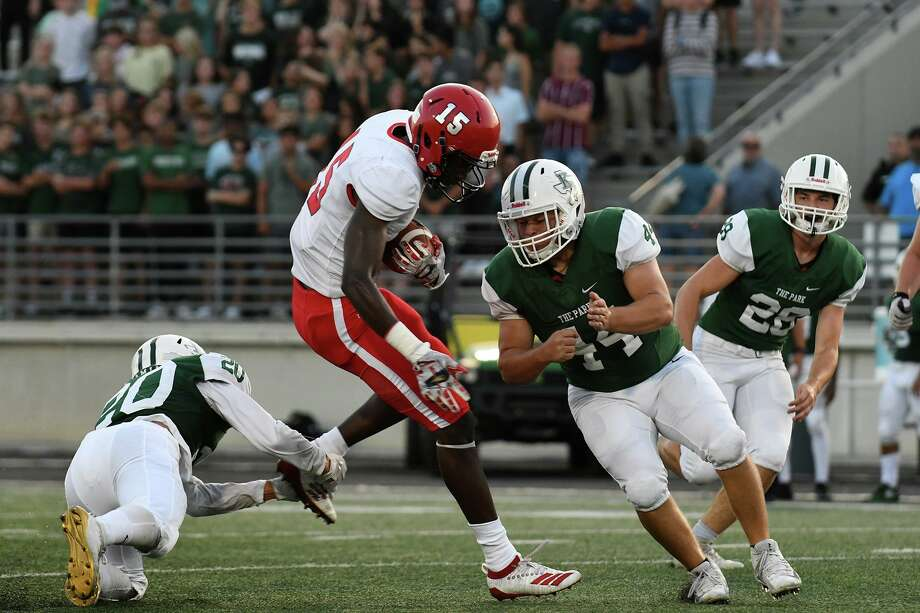 Kingwood Park senior linebacker Thomas Kirby ((44) and junior defensive back Brandon Acosta (20) team-up to stop Waltrip senior receiver Orvis Fowler (15) in the 1st quarter of their matchup at Turner Stadium in Humble on Sept. 5, 2019. Photo: Jerry Baker, Houston Chronicle / Contributor / Houston Chronicle