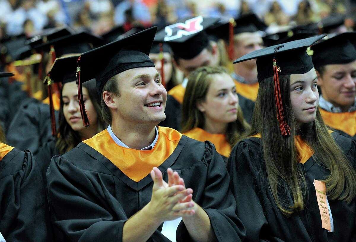 Thomas Formus applauds during Ridgefield High School's graduation ceremony held Friday, June 22, 2018, at the O'Neill Center at Western Connecticut State University.